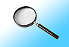 Magnifying glass over light blue | Stock Foto