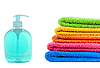 Blue soap bottle and stacked colorful towels | Stock Foto