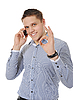 Smiling young man talking on the phone | Stock Foto