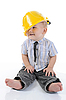Happy child in yellow builder helmet | Stock Foto