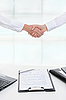 Photo 300 DPI: Handshake of two business partners