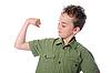 男孩展示他的肌肉 | 免版税照片
