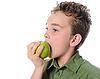 Boy eats an apple | Stock Foto