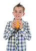 Boy holding fresh orange | Stock Foto