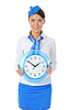 Attractive stewardess with clock | Stock Foto