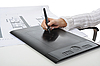 Photo 300 DPI: hand on graphic tablet