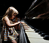 Photo 300 DPI: girl playing on an piano.