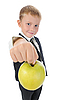 Boy holds out an apple | Stock Foto
