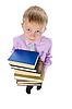 男孩持有一叠书 | 免版税照片