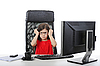 Little girl wears glasses at the table with computer | Stock Foto