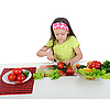 Little girl cut fresh tomatoes | Stock Foto