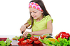 Little girl cut fresh tomatoes. | Stock Foto