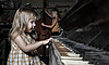 Photo 300 DPI: girl playing on an old piano