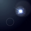 Shiny light lens flare on dark blue background