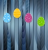 Vector clipart: Flat Easter eggs on blue wooden texture background