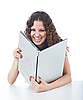 Beautiful young woman holding laptop | Stock Foto