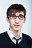 Cute young guy with fashion haircut wearing glasses | Stock Foto