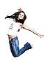 청바지에 소녀 흰색 배경에 점프   Stock Foto