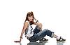 困惑的年轻女舞者坐在地板光泽 | 免版税照片