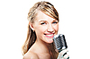 Girl singing into retro microphone | Stock Foto