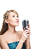 Pretty young girl singing into retro microphone | Stock Foto