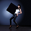 Stylish young lady holding blank black board | Stock Foto