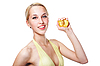 Beautiful woman squeezes out juice of peach | Stock Foto