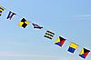 Photo 300 DPI: Flags on blue sky