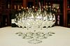 Row of glasses, wine bottles on background | Stock Foto