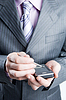 Close-up of businessman in dark gray suit | Stock Foto