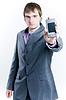 商人显示手机 | 免版税照片
