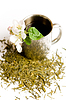 Cup of tea with flower and tea leaves | Stock Foto