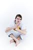 Serious teenager sitting in lotus poses | 免版税照片