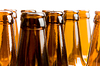 Close-up of beer bottles, focus on middle one | Stock Foto