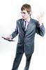 Upset businessman with calculator | Stock Foto