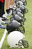 Row of football helmets   Stock Foto