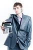 Tired businessman with calculator | 免版税照片