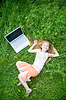 Funny little girl with laptop outside | Stock Foto