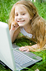 Smiling little girl with laptop | Stock Foto
