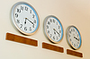 Row of clocks with different time | Stock Foto
