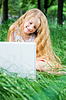 Serious looking little girl with laptop | Stock Foto
