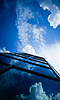Skyscraper reflecting clouds   Stock Foto