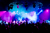 People dancing at concert, anonymous girls on stage | Stock Foto