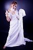 Young girl in wedding dress gesticulating | 免版税照片