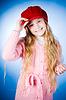 Little girl holding cap | 免版税照片