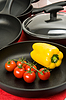 Still-life with fry pans and vegetables | Stock Foto