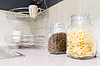 Pasta and coffee beans in glass jars | Stock Foto