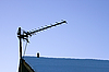 Photo 300 DPI: Television antenna over the snowy roof