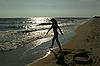 Silhouette of teenage girl on beach | Stock Foto