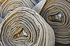 Photo 300 DPI: Several old rolled fire hoses